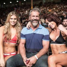 Hollywood star Mel Gibson is showing off his great physique with the UFC octagon girls during a recent event. Gibson has been using TRT for years.